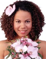Small curls black wedding hairstyle with flowers.jpg
