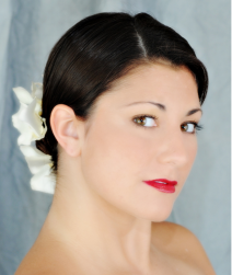 Simple classy briddal hairstyle with white flowers hairclip on the lower back.PNG