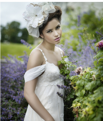 Vintage bride hairstyle with big floral hairclip image.PNG