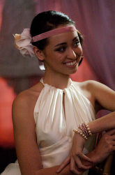 Young style wedding hairstyle with cute pink headband and flower.PNG