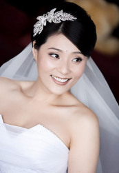 Asian bridal hairstyle with a large beautiful crystal floral hairclip image.PNG