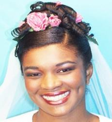 black wedding updo with pink flowers.jpg