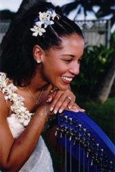 black wedding hairstyle with tropical flowers.jpg