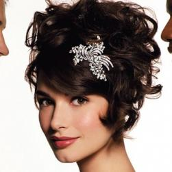 cute curly wedding updo with side bang and clip.jpg