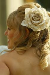 Curly wedding with half up hairstyle with big flower.jpg
