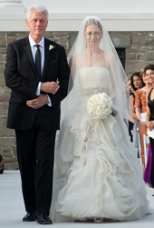 Chelsea Clinton's wedding photos of former president Bill Clinton walking on the aisle.PNG