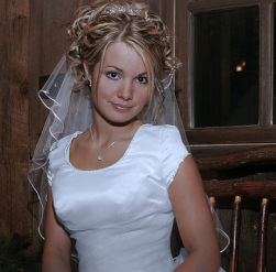 Curly wedding hairdo with veil and terria photo.PNG