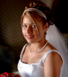 Elegant curly wedding updo with crystal head band.PNG