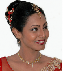 Indian bride hairstyle with red flowers.PNG