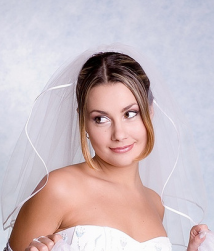 Simple wedding hairdo with very side bangs with veil.PNG