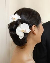 beach wedding hairstyle with two white tropical flowers.jpg