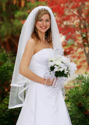 Simple elegant wedding hairstyle with veil and terria.PNG