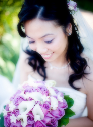 Asian curly bride hairdo with veil and fresh flowers hairclilp.PNG