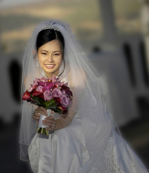 Classic bridal hairstyle for Asian women with veil and terria.PNG