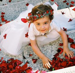 Beautiful flower girl covered with red roses.PNG