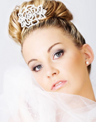 Chic wedding hairstyle with crystal hairclip and veil.PNG