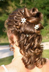 Summer wedding hairstyle with curls and floral hair clips.PNG