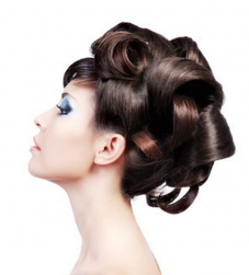 Elegant Asian bride hairstyle with big rolls.PNG