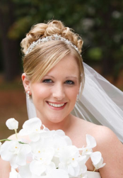 Beautiful classic bridal hairstyle updo with tarria and veil.PNG