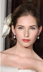 Modern wedding hairstyle with big white flower hair clip images.PNG