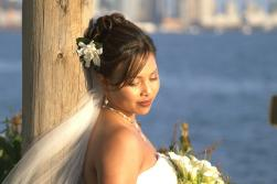 Hawaiin wedding hairstyle with flower and veil.jpg