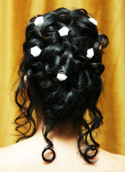 Bridal updo hairstyle with big curls and floral clips.PNG