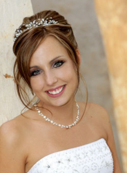 Classic bridal updo with pearl tiara.PNG
