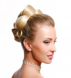 Elegant wedding hairstyle with big rolls.PNG