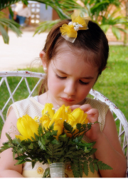 Pictures of flowers girl hairstyle with cute little yellow bow.PNG