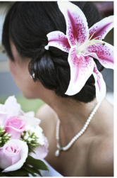 Asian brides picture with her hair low updo with big pink and white lily fresh flower.PNG