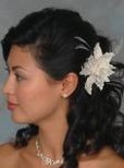 Asian wedding hairstyle with floral clip.jpg