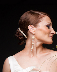 Classic wedding hairdo with lower knot and a simple trendy hairclilp.PNG