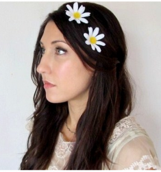 Hair down wedding hairstyle with floral hairclips and side bangs.PNG