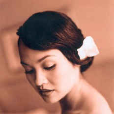 Asian bride low updo with flower clip.jpg