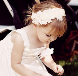 A beautiful fabric floral headband is a great tips for flower girls hairstyles.PNG