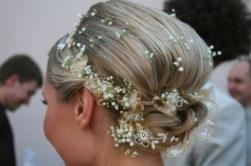 elegant bride updo with small fresh flowers.jpg