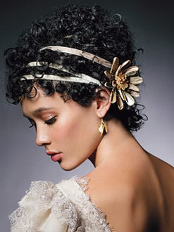 curly updo with floral head band for wedding.jpg