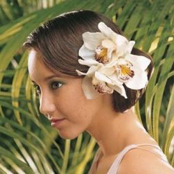 class beach wedding hairstyle with big tropical flowers.jpg