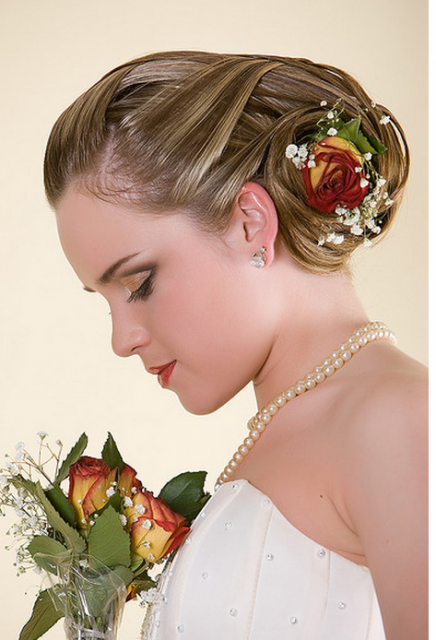 Bridal hairstyle with red rose hair clip.PNG