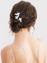bride updo with small white flowers.jpg