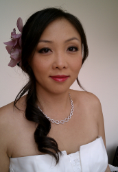 Asian tropical bridal hairdo with fresh flower hairclip.PNG