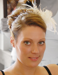 Simple bridal hairstyle with floral side hairclip.PNG