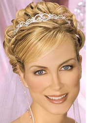 Elegant blonde hair wedding hairstye with side bangs and curls.PNG