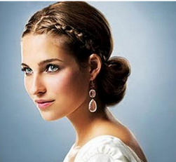 Elegant bridal with braids in the front with a knot in the back.PNG