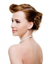 Pretty bride hairstyle with curvy bangs.PNG