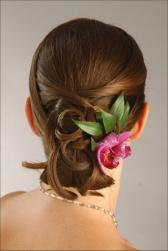 beach bridal hairstyle with tropical flower.jpg