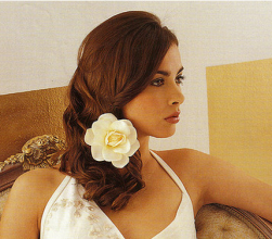 Long half wedding hairstyle with white floral hairclip image.PNG