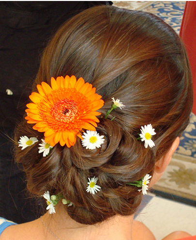 Summer bride hairdo with fresh flowers with orange flower and white flowers.PNG