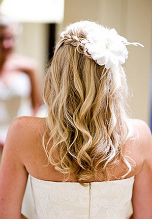 Wavy long bridal hairdo with half up styles with floral hairclips.PNG