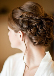 Braid bride hairstyle with straight swept bangs.PNG
